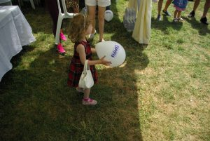 a girl playing with a baloon